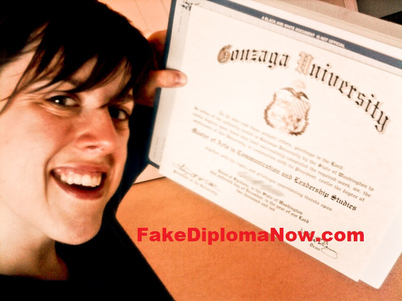 woman holding gonzaga university diploma